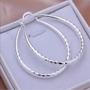 Jewelry - LARGE SILVER OVAL DANGLE HOOP DIAMOND CUT DESIGN